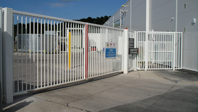 white-swing-gate-with-pedestrian-access-gate